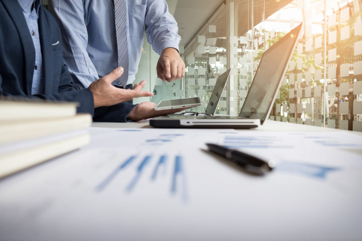 Business adviser analyzing financial figures denoting the progress in the work of the company.