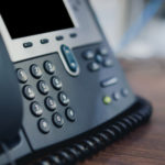 Office telephone close up using cloud voice services.