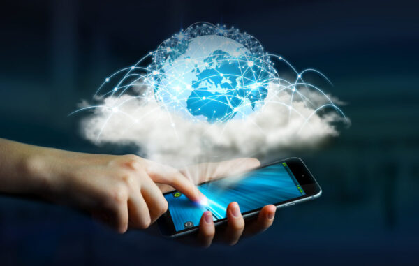 Mobile phone with cloud and network symbol graphic above.