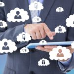 Businessman holding a tablet with cloud icons surrounding. Using a smart device for work with cloud voice services.