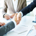 Business agreements close up of two men shaking hands